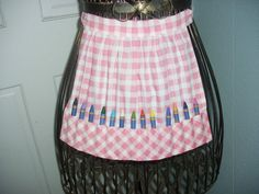 Trust me Grandma, I won't color the walls, Apron with color crayons.Great for the little helper. $9.00, via Etsy.