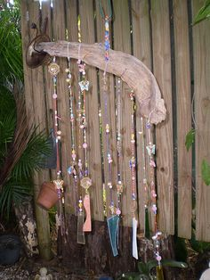Make a wind chime from old  beads and jewelry <3