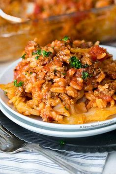 Unstuffed cabbage casserole is the perfect way to enjoy lazy cabbage rolls! Ground beef, pork & rice with a cabbage layer in a rich tomato sauce. Best Cabbage Recipe, Cabbage Recipes, Pork Recipes, Cooking Recipes, Healthy Recipes, Recipies, Easy Recipes, Budget Recipes, Healthy Meals