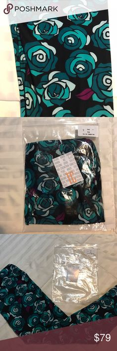 Lularoe Disney roses leggings TC Unicorn alert! You need to grab these fast! Black background with beautiful teal Disney rose flowers with purple leaves. Brand new with tag! Bought straight from consultant. TC fits size 10-22. Shipped as pictured. LuLaRoe Pants Leggings