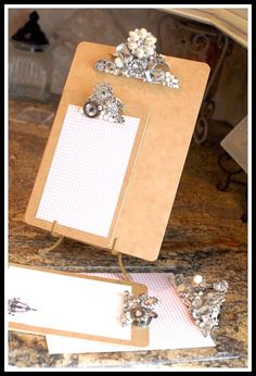 "Fancy clipboard tutorial (I have an aversion to the word ""Bling."") These would be cute in a group of three or so hung on the wall to clip photos, cards, etc and easily switch them out with the seasons, holidays, etc. #Crafty RePurpose"
