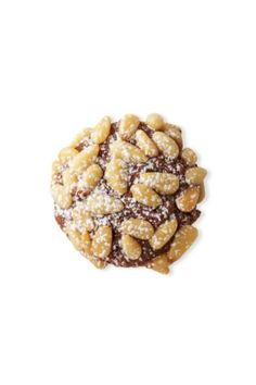 Spritz Cookies: Chocolate Pignoli- Make Basic Spritz Cookies recipe. Roll level tablespoonfuls of chocolate spritz dough into balls. Dip half of each ball into lightly beaten egg white and then into pine nuts, pressing gently so nuts adhere. Place on baking sheets, nut side up, 2 inches apart. Bake 16 minutes. Cool as directed. Lightly dust with confectioners' sugar. Makes 30 cookies. Get the full recipe at redbookmag.com.