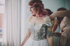Sparkly silver off-the-shoulder wedding dress | Image by Ten21 Photography