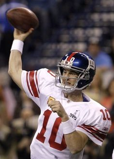 Giants win! New York Giants quarterback Eli Manning throws a pass during the first half of the NFL Super Bowl XLVI football game against the New England Patriots on Sunday, Feb. 5, 2012, in Indianapolis. David J. Phillip / AP Photo