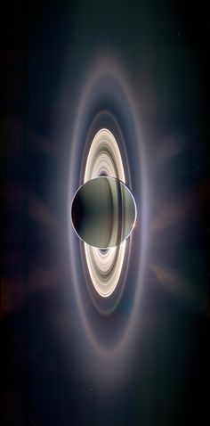 Saturn back-lit by the Sun ~ Taken by the robotic spacecraft Cassini. ~ Cassini was sent by NASA and ESA (European Space Agency) to study Saturn and its moons.