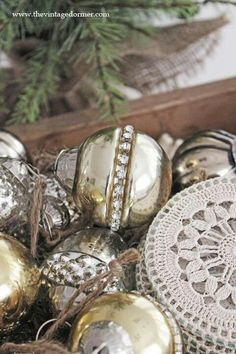 Silver ornaments and white lace - love the silver jeweled ornaments