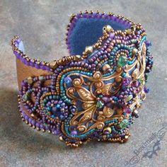A bead embroidered cuff bracelet, worked around a vintage brass filigree.  (this was #4 in this series)