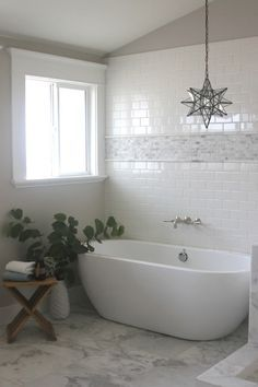 Home Bathroom with Subway Tiles - Transitional - bathroom - Greige Design Unravelling The Mystery Of Marble Tile Bathroom, Bathroom Flooring, Marble Mosaic, Marble Floor, Design Bathroom, Bathtub Tile, Bathroom Cabinets, Bathroom Vanities, Bad Inspiration
