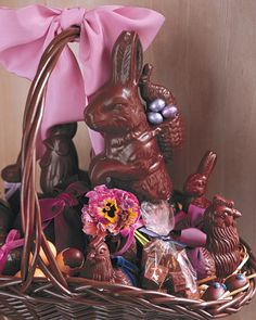 Chocolate Bunnies and Pansies Easter Basket    When you're in the room with this extravagant brown basket, every fragrant breath is like a moment in a chocolate shop. Set out at an Easter party, it would make a wonderful centerpiece -- then dessert.