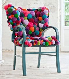 """This """"pompom"""" chair is just plain awesome for an adult to read aloud to a kid in. It also matches the pompom rug! #PrimroseReadingCorner"""