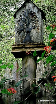 (birdhouse - rather appropriate design of a tree - no instructions, would be easy to build from wood and paint the tree, or use jeweler's saw to cut metal tree, or approximate tree with wire sculpture mounted on birdhouse ~TA)