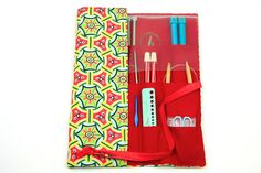 A vibrant case keeps their knitting supplies at the ready.