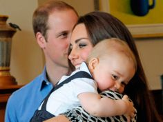 Nestled into his mother's shoulder with a cheeky grin on his face and Prince William smiling in the background, George was photographed cuddling up to Kate on a visit to Government House in Wellington.