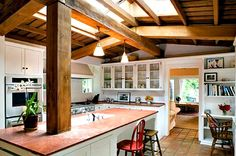 Marilyn's house still retains its unpretentious charm. Love the kitchen: