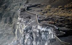 Tourists observe the main crater of the Santiago volcano at the Masaya Volcano National Park in Nicaragua