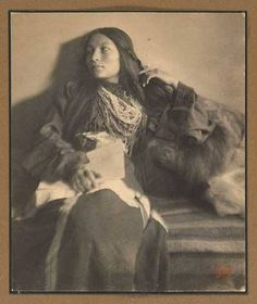 Zitkala-Ša or 'Red bird' (1876–1938), the child of a full-blood Yankton Sioux, was born in 1876 on Pine Ridge Reservation in South Dakota and raised in a tipi on the Missouri River until age 12. She went to a Quaker missionary school for Indians, under the missionary-given name Gertrude Simmons Bonnin, eventually becoming a teacher, musician, author and activist.