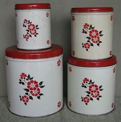 Hall China Red Poppy Metal Canister Set. My Mom collected Hall. She gave the orange poppy set with complete service for six, various serving dishes ,tin ware and tea pots. It's in our attic! My two sister each got the red poppy and autumn leaf. - Dee