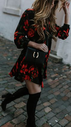 Boho Winter outfit styled with red and black floral swing dress, black over the knee boots, and Sancia crossbody bag