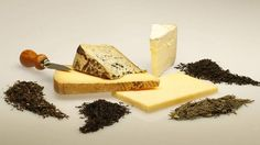 Cheese and tea pairings: Delice de Borgogne (far right) and first flush Darjeeling (far left); aged raw milk Gruyere (back center bottom) and Lung Ching Dragonwell (second from right); extra-sharp Cheddar (front bottom) and Keemun Hao Ya (second from left); and Valdeon Spanish blue (center rear) and Lapsang Souchong (far right).