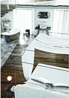 love how the bath is organically in the room with view out the door