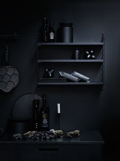 all black, wall, string shelf, kitchen accessories.  facing north with gracia: String, a walk to the dark side
