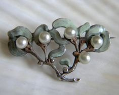 Art nouveau pin, enamel and pearls.