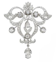 Diamond and White Gold Pendant/Brooch  The floral openwork design suspending a pear-shaped diamond weighing approximately 0.60 carat, further decorated with a smaller pear-shaped diamond and round diamonds totalling approximately 2.25 carats, mounted in base metal and 14k white gold, from a fine trace linking 18k white gold necklet, length 17 ins