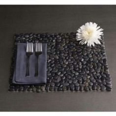 Stone placemat with charcoal linens and white flowers