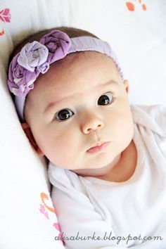 "DIY upcycled baby headband from alisa burke ""Luckily I found that the waistband of Lucy's ""too short"" pants actually fits perfectly around her head. This may not always be the case so you could simply just use a piece of brand new elastic"""