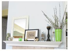 mantle - love sticks in vase