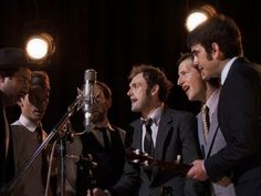 """The Punch Brothers, Marcus Mumford sing """"The Auld Triangle""""  I didn't know Marcus could sing that low!!  His face at 2:34 is priceless:-)"""