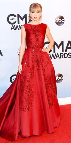 Taylor Swift went big at the CMA Awards in a deep red embellished Elie Saab dress an a matching red lip.