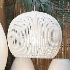 This white rattan pendant light is a stunning conteporary option for integrating natural materials into your space!