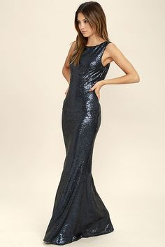 Shimmer with every step you take in the Slink and Wink Matte Navy Blue Sequin Maxi Dress! A rounded neckline and sexy cowl back top a darted, sleeveless bodice. Small matte sequins travel gracefully down a straight-cut maxi skirt. Hidden side zipper with clasp.