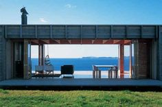 This amazing New Zealand beach house is like the perfect sun porch during the day…
