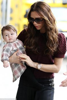 Fashionable flight: Victoria Beckham ensured baby daughter Harper looked her best as they boarded their flight at LAX