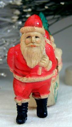 Vintage Celluloid or Viscaloid Santa Pulling Sleigh of Gifts.