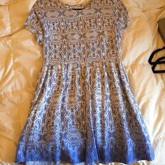 LF Ombré dress with cross back LF dress worn once! Adorable print and colors for so many occasions. It's just slightly too snug on me but in perfect condition. The back has a cool lace up detail meanwhile the front is classy and conservative. Price negotiable 💗 LF Dresses
