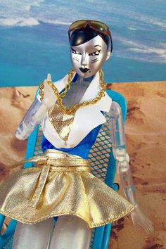 Resort Wear, 2015 - Gigi is *so* ready for the Sun- it has been a long, long, loooong Winter. And what a rough one it must have been, too, to have such an effect on a cyborg! *wink*  Gigi is a Dolls Ahoy! custom-painted Obitsu head on a translucent Obitsu body. Swimsuit from vintage 'Sea Holiday' Barbie. Skirt is vintage Genuine Barbie. Necklace and platform sandals (not pictured) by Barbie Basics. Sunglasses from Monkey Depot   by Charles Rodstrom    Flickr