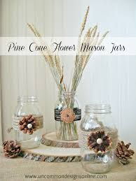 Pine cone flowers on vases in centre piece