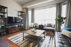 Natural details, plants, practical attractive furniture and this bachelor pad hits all the right understated notes.