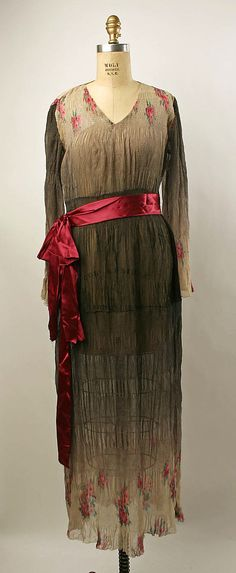 Afternoon dress Date: 1935–39  I'm sorry but except for the waist ribbon, this dress offers nothing to the female.
