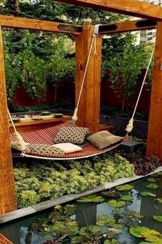 Asian Landscape/Yard with Fence, Pond, Custom Hammock-Daybed by Jamie Durie, Garden water feature, Trellis, Koi pond