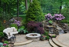 Traditional Landscape/Yard with Hydrangea - Forever Pink, Palletized Rock, Fire pit, exterior tile floors, Fountain, Pond