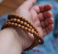 These sandalwood malas smell delicious! You can infuse them with your own favorite essential oils.