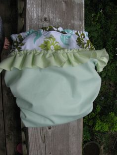 Cloth diaper sewed from PUL and Joel Dewberry Aviary 2 damask in dill lined with dimple velour in white with a little ruffle on the back in celery
