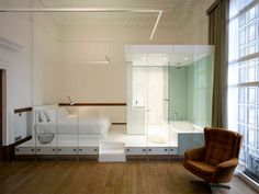 frameless glazing partitions to create pods at the Town Hall Hotel renovation by IQ - Hotels Design Architecture Open Plan Bathrooms, Open Bathroom, Glass Bathroom, Bathroom Stuff, Washroom, London Hotels, White Bedroom Suite, Hall Hotel, Interior Architecture