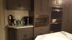 This is my new kitchen! Coffee area along with double oven and microwave. I love my gray wood cabinets.