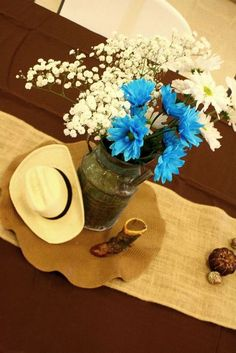 Centerpiece ideas - milk can as vase - western cowboy baby shower with camo ribbon bow! Cowboy Centerpieces, Baby Shower Centerpieces, Baby Shower Decorations, Centerpiece Ideas, Cowboy Theme, Cowboy Party, Western Cowboy, Western Theme, Texas Western