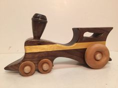 Wooden Toy Train Steam Locomotive handcrafted in a very artistic design. Made from domestic walnut & exotic yellowheart inlay. 100% Wood